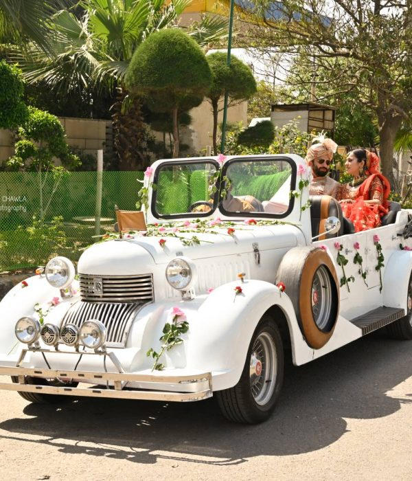White vintage car and married couple