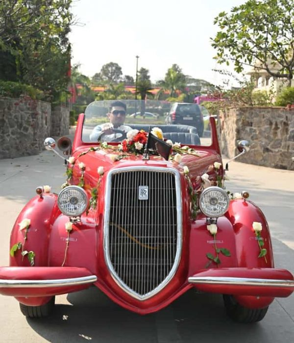 Groom self drive red vintage car rental