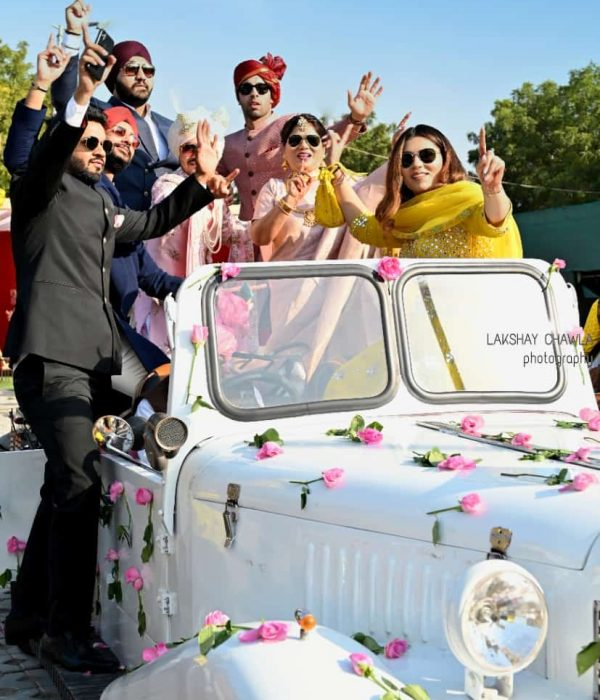 Indian Grroom dancing on his way to wedding on white vintage car