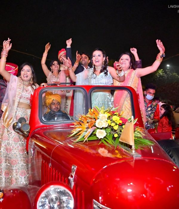 sisters on vintage car for marriage